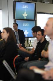Facebook Seattle employees attend the opening of their new downtown Seattle offices Thursday.