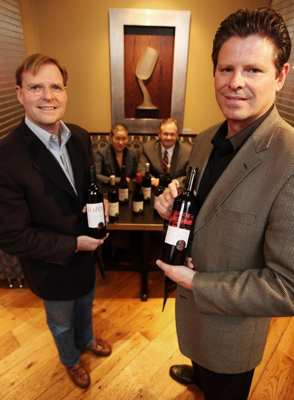 Sozo Friends co-founders Martin Barrett (left) and Monte Regier display some of their wines while Boka sommelier Mi-Suk Ahn (left) and general manager Denny Fitzpatrick look on in their Seattle restaurant. Boka's menu includes Sozo Friends wines.
