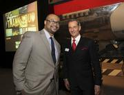Wells Fargo Bank's Rod West with Puget Sound Business Journal Publisher Gordon Prouty at the 2013 Book of Lists Extravaganza. West won the drawing for round-trip tickets on Emirates Airlines. Emirates is a gold sponsor of the Book of Lists and gala.