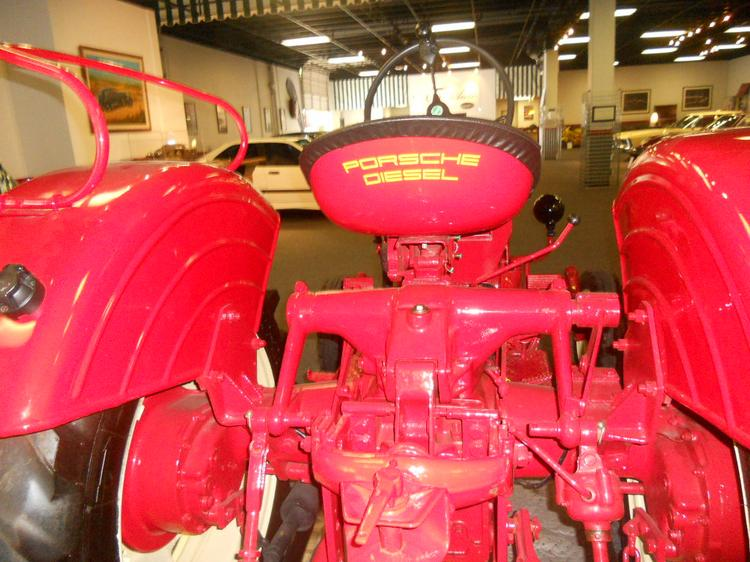 Classic Porsche diesel tractor from 1950's, on display as part of collection at Club Auto Kirkland