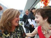Susan Hutchison, left, chats with Pam Eakes , awaiting remarks by Dale and Leslie Chihuly at a pre-opening party for Chihuly Garden and Glass, which opens to the public Monday, May 21.