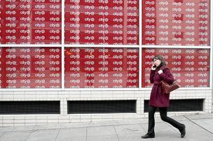 Pedestrians walk by the new CityTarget store slated to open this summer in downtown Seattle.