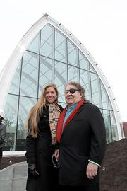 Leslie and Dale Chihuly outside of the glass house at the Chihuly Garden and Glass at Seattle Center. They have announced a tentative opening date of May 21.