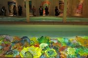 The swimming pool at Dale Chihuly's Boathouse features a display of Persian glass at the bottom. A flat transparent floor sits just above the colored glass.