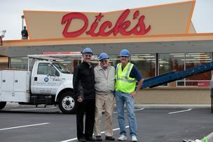 Dick's Drive-In namesake and co-founder Dick Spady, center, with his sons Jim, left, and Walt in front of the new Edmonds Dick's Drive-In.