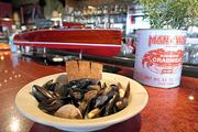 The steamed clams and mussels in garlic, butter and wine at the counter at Seatown in Pike Place Market.