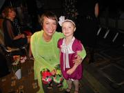 "Left to right: Caroline Mancini and 5-year-old Anna Comstock were among the cancer survivor models in the 15th annual ""Surviving with Style"" fashion show and luncheon benefiting Gilda's Club Seattle on Thursday at the Westin Seattle."