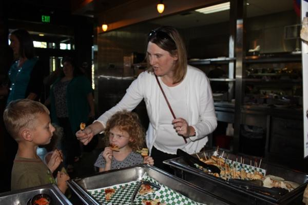 Angie Weedon and her children, Kellen, 6, left, and Annika, 4, sample the new Healthy Meals Happy Kids menu at The Ram Restaurant & Brewery in Lakewood.