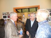 Left to right: Bob Wallace, Howard Lincoln, and John Ellis chat at JIm Ellis's birthday party.