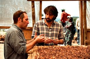 Theo Chocolate CEO Joe Whinney (left) and actor and movie director Ben Affleck inspect cocoa beans in eastern Congo. Theo and Eastern Congo Initiative, a group founded by Affleck, are working together to help improve the lives of the region's farmers and their families.