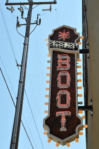The Kickin' Boot sign heralds Southern-style barbecue in Ballard.