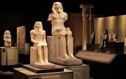 """At the """"Tutankhamun: The Golden King and the Great Pharaohs"""" exhibit at the Pacific Science Center, the first artifacts visitors see are the two statues at center. Center left is a statue of King Khafre, who built the second-largest pyramid in Egypt and whose face is on the Sphinx at Giza. The center right statue is of his son Menkaure, who built the smallest pyramid at Giza."""