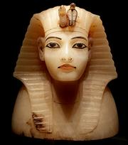 This calcite lid for a canopic vessel was carved in the shape of King Tutankhamun's head and is on display at the King Tut exhibit at the Pacific Science Center. The vessel held King Tut's internal organs.
