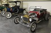 Left, a 1914 Ford Model T Roadster as it was produced from the factory. On the right is a 1923 Ford Model T T-Bucket Roadster that was converted to a hot rod on display on the motorsports level of the LeMay - America's Car Museum.