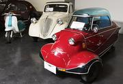 "Left to right: The micro-car display at the LeMay - America's Car Museum includes a 1960 Lambretta Series II Li150 Scooter, a 1937 Fiat Topolino 500 and a 1956 Messerschmitt KR200 cabin scooter with a bubble top, often called the ""Cinderella Coffin."" Messerschmitt was a German aircraft manufacturer during World War II. After the war, the factory was retooled to produce the KR200. The bubble top design was from airplanes the factory used to produce."