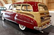 A 1950 Oldsmobile Futuramic 88 Wagon, a 4-door station wagon, at the LeMay - America's Car Museum. The car was all metal, including the wood-grained panels.