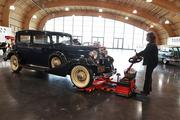 LeMay - America's Car Museum Collection Manager Renee Crist moves a 1933 Cadillac sedan into the museum's Grand Gallery.