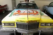 "A 1976 Cadillac ""Wailer Mobile"" on display in the LeMay - America's Car Museum.  The car was featured on the cover of the Wailers' CD ""Cadillac to Mexico"" released in 2001 and the ""Wailer Mobile"" went on tour with the group. The car was also used to promote ""LouieFest,"" a summer music and arts festival in Tacoma."