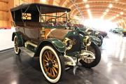 A 1913 REO The Fifth ST5 (left) on display at the LeMay - America's Car Museum. REO was founded by Ransom E. Olds of Oldsmobile after he was forced out. The band REO Speedwagon was named after a different model by the same manufacturer.