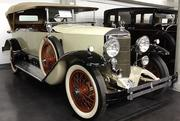 A 1922 Austro Daimler 4-door sport 7-passenger touring car designed by Ferdinand Porsche on display in the LeMay - America's Car Museum.