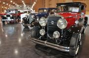 A 1929 Cadillac Series 34-B Victoria Coupe (right) is part of a sampling of cars from Harold E. LeMay's collection on display in the Grand Gallery of the LeMay- America's Car Museum.