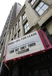 """Seattle Art Museum is working with the Seven Seas building, former homne of peepshow The Lusty Lady, to promote SAM's """"Elles"""" show."""
