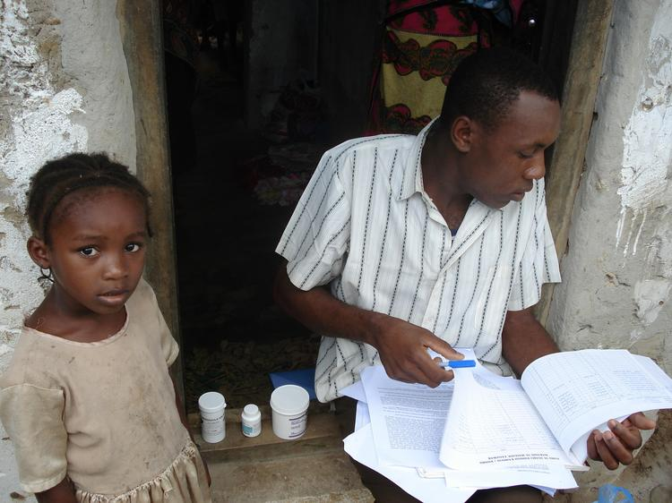 Triple drug administration in Zanzibar: Health worker recording treatment of three drugs dispensed to villagers living in areas endemic for lymphatic filariasis, schistosomiasis and soil-transmitted helminthes