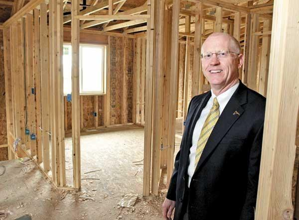 """Mark Duffy, CEO of Snohomish County's Mountain Pacific Bank, says the lender shed its """"troubled"""" status by building homes on foreclosed lots instead of abandoning the land. Almost every home has sold."""