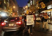 Several hundred Occupy Seattle protesters march from Westlake Park to the Sheraton Hotel in Seattle where Jamie Dimon, chairman and CEO of JPMorgan Chase & Co. was delivering a speech on Wednesday.