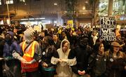 Several hundred Occupy Seattle protestors lock arms to surround the downtown Seattle Sheraton where Jamie Dimon, chairman & CEO of JPMorgan Chase & Co. was delivering a speech on Wednesday.