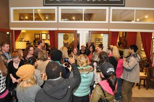 Actor Patrick Dempsey is greeted by a crowd at a Tully's coffee shop in Bellevue's Lincoln Square on Friday. Dempsey's investment group Global Baristas was the high bidder at  approximately $9.15 million for Tully's Coffee in Thursday's auction of  the bankrupt coffee shop chain.