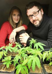 """CannaPi Consulting President and CEO Abigail Guthrie (left) and her brother, Vice President for Operations Chris Guthrie, with """"starter"""" medicinal marijuana plants at CannaPi's Seattle offices."""