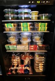 """A wine refrigerator at CannaPi Consulting holds locally made """"medibles,"""" or edible products containing medicinal marijuana, at CannaPi's Seattle offices."""