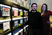 CannaPi Consulting President and CEO Abigail Guthrie (right) and her brother, Vice President for Operations Chris Guthrie, with a display of various strains of marijuana at CannaPi's Seattle offices.