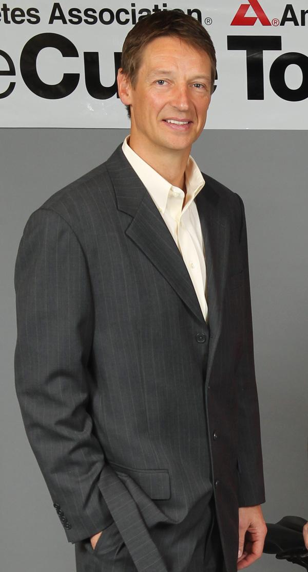 Former Seattle Supersonics player Detlef Schrempf is pictured in the photo studio at the Puget Sound Business Journal hours before Seattle Mayor Mike McGinn and King County Executive Dow Constantive held a press conference Thursday (Feb. 16) to discuss their collaboration with investor Christopher Hansen to potentially bring an NBA basketball and NHL hockey franchise to Seattle.