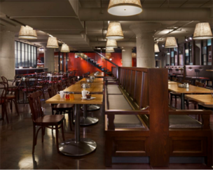 "An upholstered banquette helps divide the dining area into ""pockets"" at Sodo Kitchen, the Starbucks corporate cafe in Seattle."