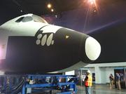 The crew compartment of NASA's space shuttle trainer moves into the Charles Simonyi Space Gallery at the Museum of Flight in Seattle.