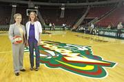 Shannon Burley, vice president of marketing for the Seattle Storm and Samantha Twardowski, of the Wunderman ad agency, at center court of KeyArena, in Seattle.