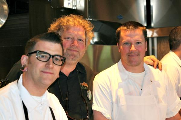 """Tom Douglas (center) and chefs Nathan Crave and Brian Walczyk are getting Tanakasan, Douglas' latest restaurant, ready for soft openings. Douglas describes it as """"LA punk, cross-Asian"""" with entrées averaging $12 to $14."""