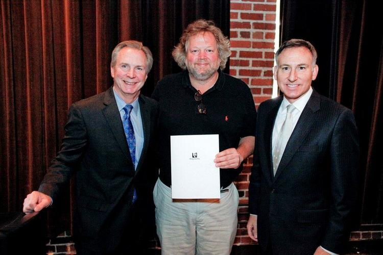 June 1 was proclaimed Tom Douglas Day at a board meeting of Seattle's Convention and Visitors Bureau this week. Left to right: Tom Norwalk, president and CEO of SCVB; Tom Douglas; King County Executive Dow Constantine.