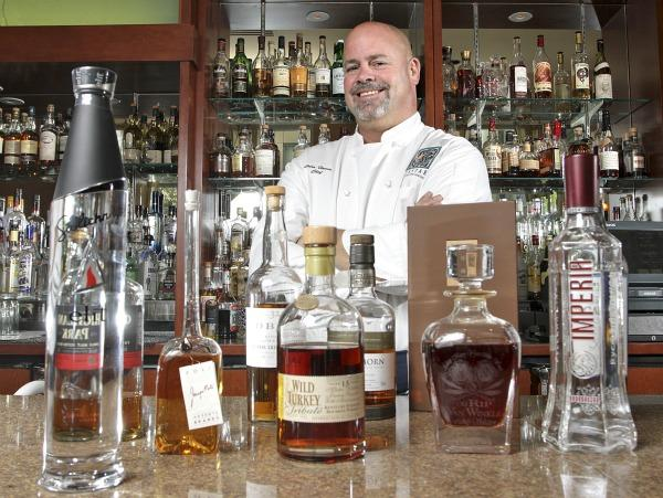 Restauranteur John Howie, shown at the bar of his Seastar Restaurant and Raw Bar in Bellevue, is making plans for a new pub dining concept in Bothell.