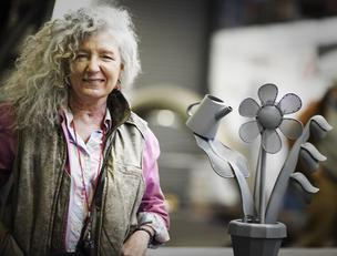 Seattle artist Ginny Ruffner with a model of Urban Garden,  ublic art animated sculpture which will start taking form full scale in downtown Seattle later this month.