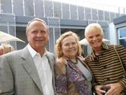 Chuck and Karen Lytle, Lytle Enterprises, flank Hermes' Detra Segar, in center, as they visit at a recent pre-opening party for Chihuly Garden and Glass, which opens to the public Monday, May 21.