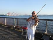 Throughout the evening, a smiling violinist played jazz and standards and set a romantic tone for the background of the secret Le Dîner en Blanc in Seattle on Saturday.