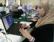 A young woman tackles a coding challenge presented by a Google engineer at a training day in Gaza, part of the new Mercy Corps Arab Developer Network Initiative.