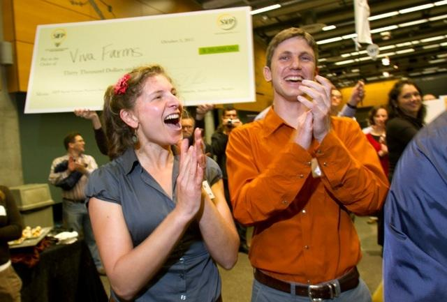 Ethan Schaffer, (right) of nonprofit Viva Farms, celebrates with his team after winning $40,000 at Seattle's first Social Innovation Fast Pitch.