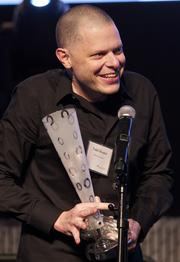 Todd Hooper of Zipline celebrates the Flashie for Gaming Development of the Year. (Photo by Stephen Brashear)