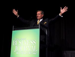Puget Sound Business Journal Publisher Gordon Prouty welcomes a crowd of more than 400 business leaders to Washington's 100 Fastest-Growing Private Companies award ceremony at Meydenbauer Center in Bellevue on Thursday.