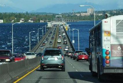 Tolling on the 520 bridge began today. A roundtrip during peak hours may run up to $10. But for Microsoft employees, the free Connector service is an option.