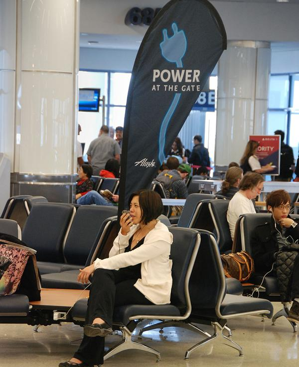 Power outlets at Alaska Airlines' gates are indicated by these new signs.